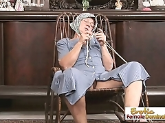 Granny keeps knitting while a horny stud fucks her hard